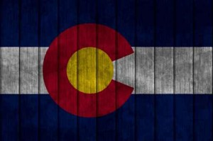 Illustration with flag in map on grunge background - Colorado